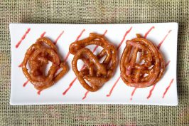 Celebrating the New Year with Rhubarb Jalebi in Cardamom Syrup