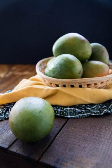 Raw mangoes under natural light